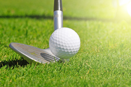 golf ball: Golf ball and driver, ready to strike, on a real golf course. Stock Photo