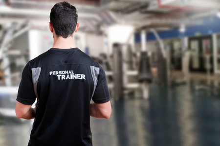 fitness trainer: Back of a Personal Trainer in a gym