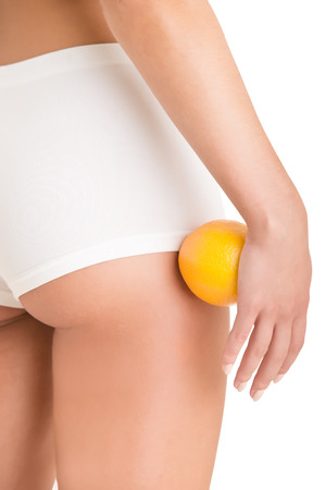 body curve: Woman Holding an Orange Against Her Thighs, isolated in white