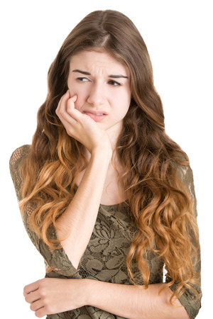 tooth ache: Woman with a tooth ache isolated in white Stock Photo