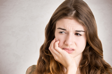 mouths: Close up of a woman with a tooth ache Stock Photo