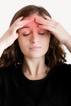 headache: Woman suffering from an headache, holding her hand to the head