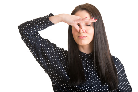 intolerable: Female covering her nose with her hand, isolated in a white background Stock Photo
