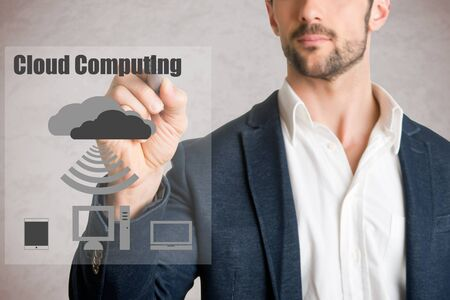 Man drawing cloud computer concept on glass, isolated in grey photo