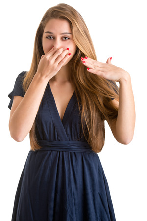 unbearable: Female covering her nose with her hand, isolated in a white background Stock Photo