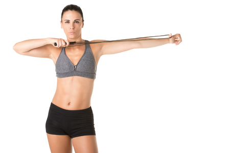 Sporty woman with a jumping rope, isolated in white Stock Photo