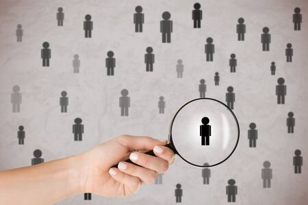selection: Concept of Human Resources selection. Hand holding loupe selecting a candidate.