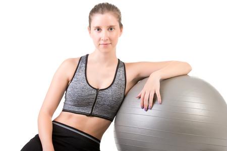 pilates ball: Fit Woman Standing Holding a Pilates Ball