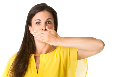 Female covering her mouth with her hand, isolated in white