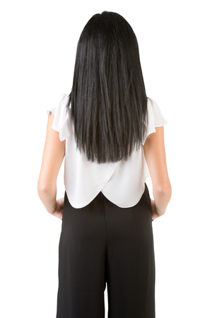 view of an elegant office: Backside of a businesswoman, isolated in white Stock Photo