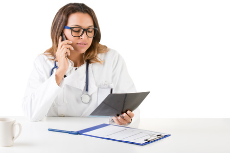phone isolated: Female doctor at work looking at an x-ray, isolated in white
