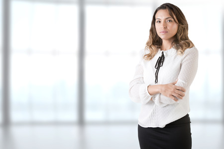 Businesswoman with her arms crossed in an office Banco de Imagens