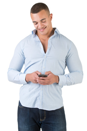 Young man using a smartphone to send a text message, isolated in white
