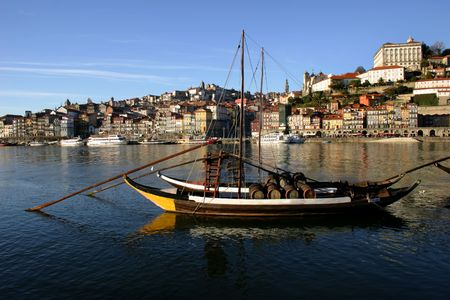 oporto: boats at the river douro in oporto, portugal