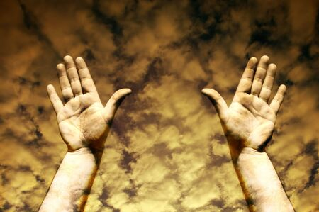 human hands in the sky toned sepia Stock Photo
