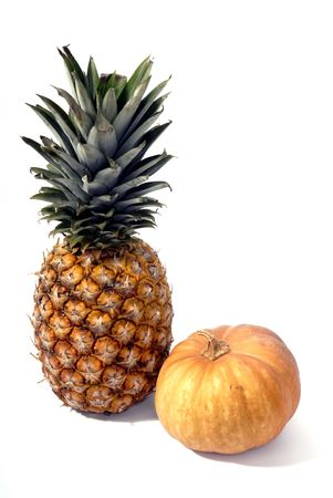 pineapple and a pumpkin in a white background photo