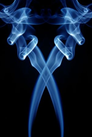 abstract blue smoke in a black background photo