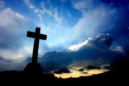 cross detail in silhouette and the clouds in the sky Stock Photo - 699365