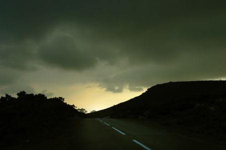 road in the mountains at sunset photo