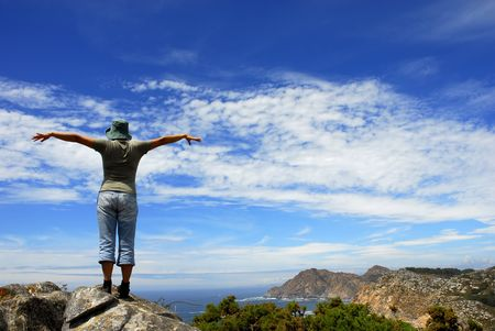 arms wide open: happy woman with arms wide open at the coast
