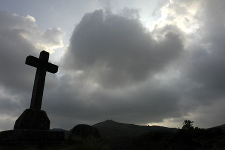 cross silhouette and the clouds