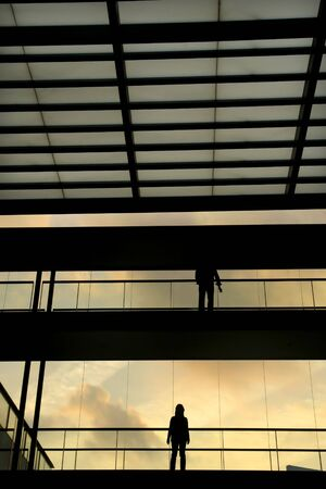 people in the modern buildind at sunset photo