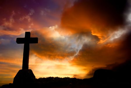 almighty: cross silhouette and the clouds at sunset Stock Photo
