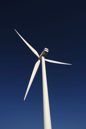 Modern white wind turbine or wind mill producing energy  photo