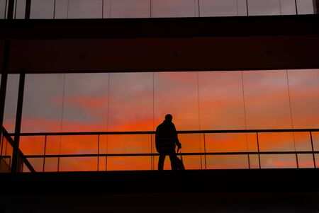 business man in the modern buildind at sunset photo