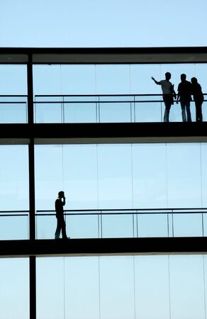 business life line: people inside the modern building in silhouette