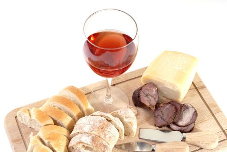 A set of food with red wine isolated on white photo