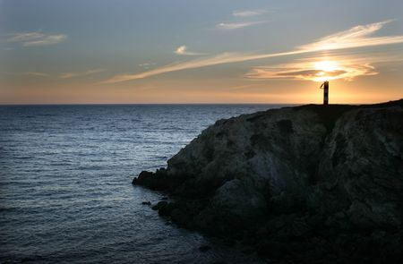 lighthouse sunset at the portuguese coast