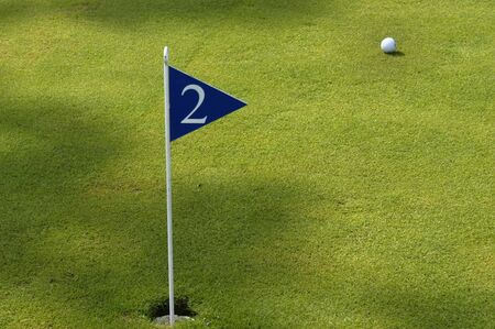 flag and ball in a green golf field Stock Photo - 877167