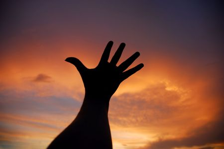 open human hand in the sunset colors