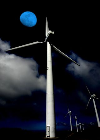 giant energy wind turbines and the moon photo