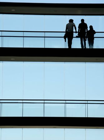workers in the modern building and the blue sky Stock Photo