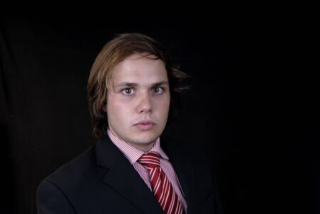 young business man portrait on black background Stock Photo - 1646962