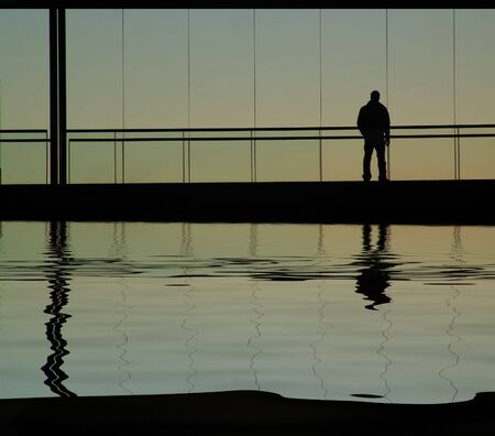 man in the building, with water reflection Stock Photo - 1745220