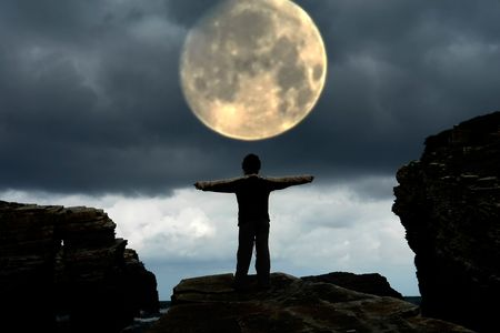 woman with arms wide open and the moon Stock Photo - 1745223