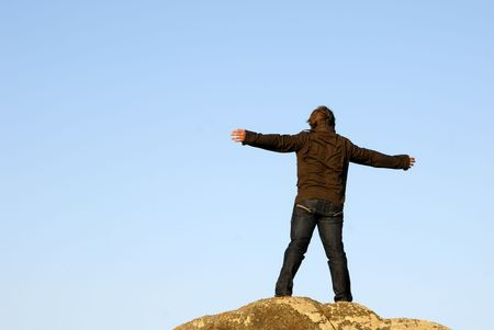 young man with arms wide open and the sky as background Stock Photo - 1754258