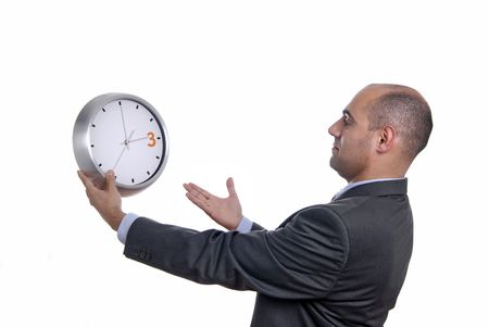 A handsome business man holding a clock photo