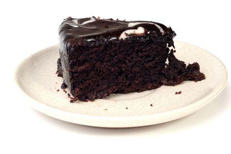 indulgent: Slice of chocolate cake isolated on white