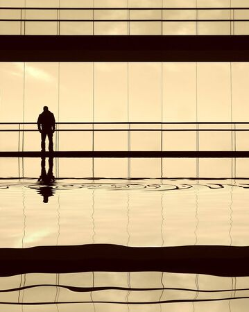 worker alone in the modern building in sepia tone Stock Photo - 1896760