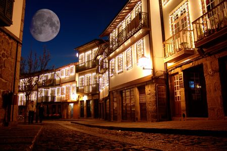 stellar: big moon over guimarares old town, in portugal