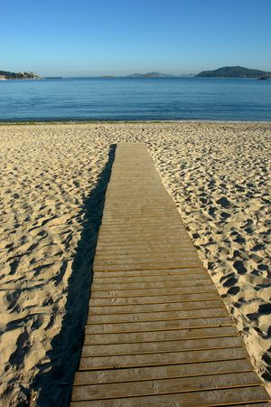wood path to the water in the beach photo