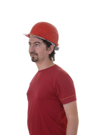 arms trade: young caucasian man worker with a red hat