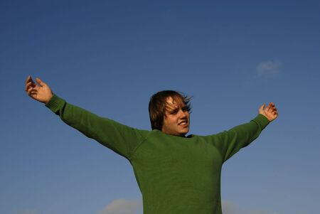 man with open arms with the sky as background Stock Photo - 2010567