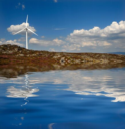 Modern white wind turbine or wind mill producing energy Stock Photo