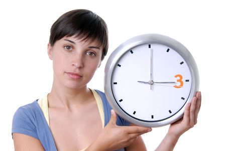 Caucasian young woman holding a big clock photo
