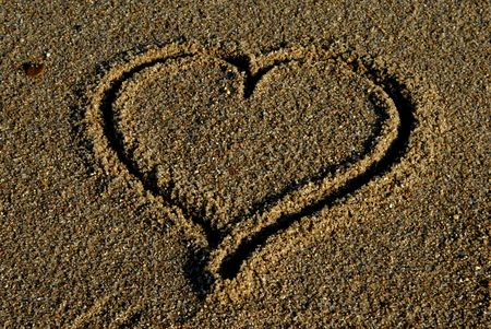 Hand drawn heart on the sand detail